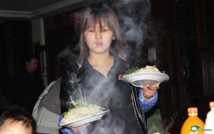 scary-chinese-waitress-cigarette-in-mouth-vacant-look-02-758x476